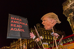 © Licensed to London News Pictures. 20/01/2017. London, UK. After protesting outside the U.S. Embassy in Grosvenor Square against the inauguration of Donald Trump as U.S. President, which took place in Washington DC today, demonstrators stage an impromptu march through the West End. Photo credit : Stephen Chung/LNP