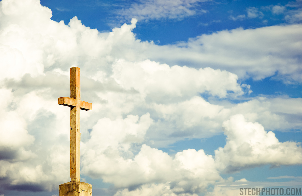 The cross at the top of a church in Gorizia, Italy.