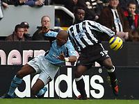 Credit: Back Page Images / Matthew Impey. Newcastle United v Fulham, FA Premiership, 7/11/2004. Olivier Bernard (Newcastle) Papa Bouba Diop (Fulham)