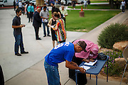 04 JULY 2012 - PHOENIX, AZ:  New citizens sign in before the naturalization ceremony in Phoenix, Wednesday. About 250 people, from 62 countries, were naturalized as US citizens during the 24th Annual Fiesta of Independence naturization ceremony at South Mountain Community College in Phoenix Wednesday. The ceremony was presided over by the Honorable Roslyn O. Silver, Chief United States District Court Judge.       PHOTO BY JACK KURTZ