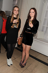 Left to right, OLYMPIA CAMPBELL and LARA SKEET at a reception to present the new Cartier Tank Watch Collection held at The Orangery, Kensington Palace Gardens, London W8 on 19th April 2012.