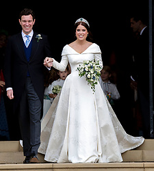 Princess Eugenie and Jack Brooksbank leave St George's Chapel in Windsor Castle following their wedding.