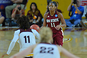 March 18, 2016; Tempe, Ariz;  New Mexico State Aggies guard Shanice Davis (11) brings the ball into the front court during a game between No. 2 Arizona State Sun Devils and No. 15 New Mexico State Aggies in the first round of the 2016 NCAA Division I Women's Basketball Championship in Tempe, Ariz. The Sun Devils defeated the Aggies 74-52.