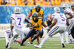 Sep 22, 2018; Morgantown, WV, USA; West Virginia Mountaineers running back Kennedy McKoy (6) runs the ball during the second quarter against the Kansas State Wildcats at Mountaineer Field at Milan Puskar Stadium. Mandatory Credit: Ben Queen-USA TODAY Sports