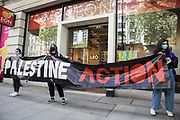 Activists from Palestine Action stand behind a banner during a protest outside the UK headquarters of Elbit Systems, an Israel-based company developing technologies used for military applications including drones, precision guidance, surveillance and intruder-detection systems, on 11th May 2021 in London, United Kingdom. The activists were protesting against the companys presence in the UK and in solidarity with the Palestinian people at a time of a significant rise in tension in Israel and the Occupied Territories following attempts at forced evictions of Palestinian families in the Sheikh Jarrah neighbourhood of East Jerusalem, the deployment of Israeli forces at the Al-Aqsa mosque and the killing of children in Gaza.
