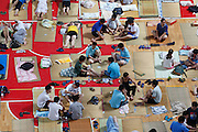 WUHAN, CHINA - JUNE 21: (CHINA OUT) <br /> <br /> To Sleep In Gymnasium <br /> <br /> Students prepare to sleep on mats laid out on the floor inside a gymnasium at Huazhong Normal University on June 21, 2013 in Wuhan, Hubei province of China. About 600 students slept inside the gymnasium to keep cool in Wuhan which reached 35 degrees Celsius (95 degrees Fahrenheit) on Saturday. The university turned on the air conditioner in the gymnasium and provided more than 450 mats for the students. <br /> ©Exclusivepix