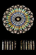 Circular stained glass window in The Cathedral of Notre Dame, Our Lady,  at Strasbourg, Alsace, France