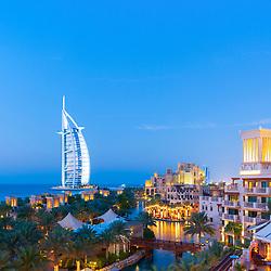 View of luxury resort hotels at  Madinat Jumeirah and Burj al Arab hotel to rear in Dubai in United Arab Emirates