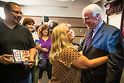 23 AUGUST 2012 - PEORIA, AZ:  Senator JOHN McCAIN (R-AZ), RIGHT, talks to DORIS GOETZ, from Goodyear, AZ, after a town hall meeting in Peoria, AZ. Sen. McCain held a town hall in Peoria, a suburb of Phoenix, to talk about the impact that sequestration would have on the Arizona economy and the Department of Defense. McCain said sequestration would immediately cost Arizona more than 35,000 defence related jobs and decimate the armed forces. Sequestration would result in about $1.2 trillion being cut from the federal budget. Sequestration, and automatic budget cuts, is scheduled to go into effect on Jan 1, 2013, if the President and Congress can't agree on budget.     PHOTO BY JACK KURTZ