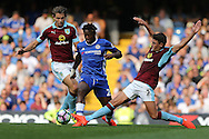 Matthew Lowton of Burnley ® tackles Michy Batshuayi of Chelsea (c). Premier league match, Chelsea v Burnley at Stamford Bridge in London on Saturday 27th August 2016.<br /> pic by John Patrick Fletcher, Andrew Orchard sports photography.