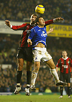 Fotball<br /> Premier League England 2004/2005<br /> Foto: SBI/Digitalsport<br /> NORWAY ONLY<br /> <br /> Everton v Manchester City<br /> Barclays Premiership<br /> 26/12/2004<br /> <br /> Tim Cahill of Everton jumps with Antoine Sibierski of Manchester City.