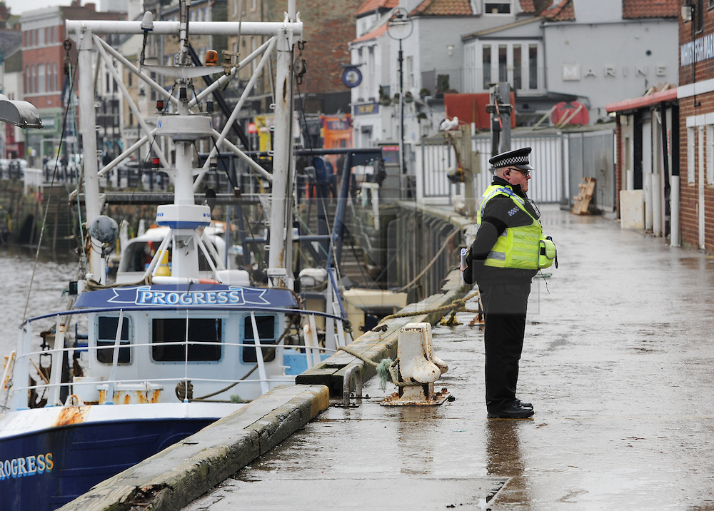© Licensed to London News Pictures. 15/01/2014. Whitby, England. Two fishermen were found dead on board their fishing boat earlier today. The men were discovered after spending the night on board the boat, the Eshcol, which is thought to be from Amble in Northumberland. The cause of the deaths is not known at this time. Photo credit : Ian Forsyth/LNP