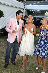 EDWARD TAYLOR and MARTHA WARD at the Concervative Party Summer Party held in the gardnes of The Royal Hospital, Chelsea, London on 3rd July 2006.<br /><br />NON EXCLUSIVE - WORLD RIGHTS