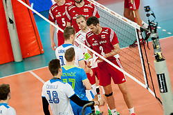 Tine Urnaut #13 of Slovenia and Michal Winiarski #2 of Poland during volleyball match between National teams of Slovenia and Poland in 4th Qualification game of CEV European Championship 2015 on May 23, 2014 in Arena Stozice, Ljubljana, Slovenia. Photo by Urban Urbanc / Sportida