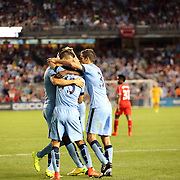 Stevan Jovetic, Manchester City, is congratulated by team mates after scoring his sides second goal during the Manchester City Vs Liverpool FC Guinness International Champions Cup match at Yankee Stadium, The Bronx, New York, USA. 30th July 2014. Photo Tim Clayton