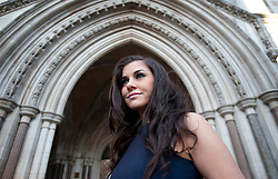 Imogen Thomas reads out her statement at the High Court, London, She gave a statement regarding her blackmail case, Thursday December 15, 2011. Pic by Gavin Rodgers/ i-Images