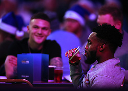Tottenham player Danny Rose and team mate Kieran Trippier watch the action during day three of the William Hill World Darts Championships at Alexandra Palace, London.