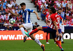 MADRID, May 7, 2018  Atletico Madrid's Filipe Luis (R) vies with RCD Espanyol's Gerard Moreno during a Spanish league match between Atletico Madrid and RCD Espanyol in Madrid, Spain, on May 6, 2018. Atletico Madrid lost 0-2. (Credit Image: © Edward Peters Lopez/Xinhua via ZUMA Wire)