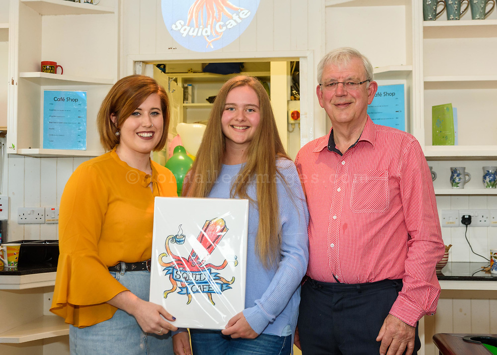 The Kinsale Youth Cafe has a new name, The Squid Cafe. Pictured at the prize giving for a competition to pick a new logo and mural was organiser Sophie Reed-Becks; mural winner Enrica Farmer and Gerry Wycherly, Squid Cafe Committee.<br />  Picture. John Allen