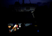 Tunisian migrants eat a meal inside a metal container on the German NGO Sea-Eye migrant rescue ship 'Alan Kurdi' in international waters off Malta in the central Mediterranean Sea, September 9, 2019. REUTERS/Darrin Zammit Lupi     TPX IMAGES OF THE DAY - RC11E5B72A70