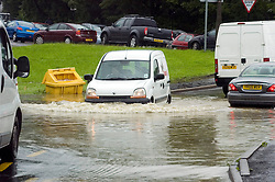 Torrential rain causes flooding and traffic chaos as vehicles try to make thier way through floodwater at the Junction of Church street and The Common Ecclesfield Sheffield South Yorkshire.25 June 2007.Image COPYRIGHT Paul David Drabble.