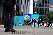 Businessmen wait to cross the road in the City of London.
