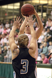 08 February 2014:  Colleen McMahon shoots over Devin Vaughn during an NCAA women's division 3 CCIW basketball game between the Elmhurst Bluejays and the Illinois Wesleyan Titans in Shirk Center, Bloomington IL