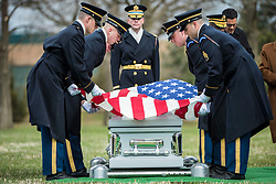 Soldiers from the 3d U.S. Infantry Regiment (The Old Guard) helps conduct military funeral honors with funeral escort for U.S. Army Air Forces Capt. Lawrence Dickson in Section 60 of Arlington National Cemetery, Arlington, Virginia, March 22, 2019.<br /> <br /> <br /> <br /> Dickson was a Tuskegee Airman (a member of the 100th Fighter Squadron, 332nd Fighter Group) and went missing in December 1944 when he plane crashed during his return from an aerial reconnaissance mission. His P-51D aircraft suffered engine failure and was seen crashing along the borders of Italy and Austria.<br /> <br /> <br /> <br /> From the Defense POW/MIA Accounting Agency (DPAA):<br /> <br /> <br /> <br /> In January 2012 researchers with the Defense POW/Missing Personnel Office (DPMO - a predecessor to DPAA) contacted Mr. Roland Domanig, an Austrian researcher who had recently reported the discovery of a separate crash site in northern Italy.<br /> <br /> <br /> <br /> In April 2012, historians and analysts from DPMO and Joint Personnel Accounting Command (JPAC, also a predecessor to DPAA) met with Mr. Domanig and additional witnesses who had seen the crash and been to the crash site. The team subsequently visited the crash site, finding wreckage matching Dickson's aircraft type in Austria.<br /> <br /> <br /> <br /> From July 11 through Aug. 8, 2017, partnered with DPAA, the University of New Orleans and University of Innsbruck conducted an excavation of the crash site. Recovered remains were sent to the DPAA laboratory at Offutt Air Force Base, Nebraska.<br /> <br /> <br /> <br /> To identify Dickson's remains, scientists from DPAA and the Armed Forces Medical Examiner System used mitochondrial (mtDNA), Y-chromosome (Y-STR) and autosomal (auSTR) DNA analysis, as well as anthropological analysis, and circumstantial and material evidence. His remains were officially accounted for on July 26, 2018.<br /> <br /> Dickson's daughter, Marla Andrews, received the flag from her father's casket during the service. <br /> <br /> <br /> <br /> (U.S. Army photo by Elizabeth Fraser / Arlington National Cemetery / released)