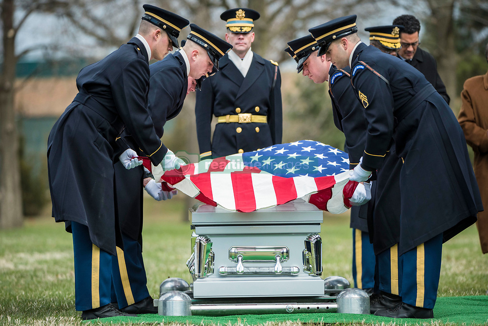 Soldiers from the 3d U.S. Infantry Regiment (The Old Guard) helps conduct military funeral honors with funeral escort for U.S. Army Air Forces Capt. Lawrence Dickson in Section 60 of Arlington National Cemetery, Arlington, Virginia, March 22, 2019.<br /> <br /> <br /> <br /> Dickson was a Tuskegee Airman (a member of the 100th Fighter Squadron, 332nd Fighter Group) and went missing in December 1944 when he plane crashed during his return from an aerial reconnaissance mission. His P-51D aircraft suffered engine failure and was seen crashing along the borders of Italy and Austria.<br /> <br /> <br /> <br /> From the Defense POW/MIA Accounting Agency (DPAA):<br /> <br /> <br /> <br /> In January 2012 researchers with the Defense POW/Missing Personnel Office (DPMO - a predecessor to DPAA) contacted Mr. Roland Domanig, an Austrian researcher who had recently reported the discovery of a separate crash site in northern Italy.<br /> <br /> <br /> <br /> In April 2012, historians and analysts from DPMO and Joint Personnel Accounting Command (JPAC, also a predecessor to DPAA) met with Mr. Domanig and additional witnesses who had seen the crash and been to the crash site. The team subsequently visited the crash site, finding wreckage matching Dickson's aircraft type in Austria.<br /> <br /> <br /> <br /> From July 11 through Aug. 8, 2017, partnered with DPAA, the University of New Orleans and University of Innsbruck conducted an excavation of the crash site. Recovered remains were sent to the DPAA laboratory at Offutt Air Force Base, Nebraska.<br /> <br /> <br /> <br /> To identify Dickson's remains, scientists from DPAA and the Armed Forces Medical Examiner System used mitochondrial (mtDNA), Y-chromosome (Y-STR) and autosomal (auSTR) DNA analysis, as well as anthropological analysis, and circumstantial and material evidence. His remains were officially accounted for on July 26, 2018.<br /> <br /> Dickson's daughter, Marla Andrews, received the flag from her father's casket du