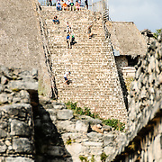 A group of tourists climb the steps of the Acropolis at Ek'Balam, one of the Mayan civilization ruins on Mexico's Yucatan Peninsula not far from Coban and Chichen Itza.