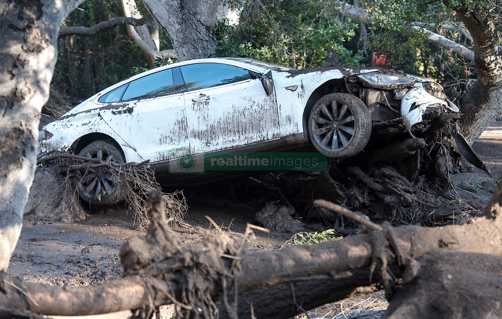 January 10, 2018 - Montecito, California, U.S. - A Tesla electric car lies destroyed by mudslides in Montecito. Areas that had been roadways, driveways, and homes, are now unrecognizable due to the large amount of mud and debris flows. At least 17 people died and 8 are still missing, as thousands fled their homes in Southern California as a powerful rainstorm triggered flash floods and mudslides on slopes where a series of intense wildfires had burned off protective vegetation last month. (Credit Image: © Santa Barbara News-Press via ZUMA Wire)