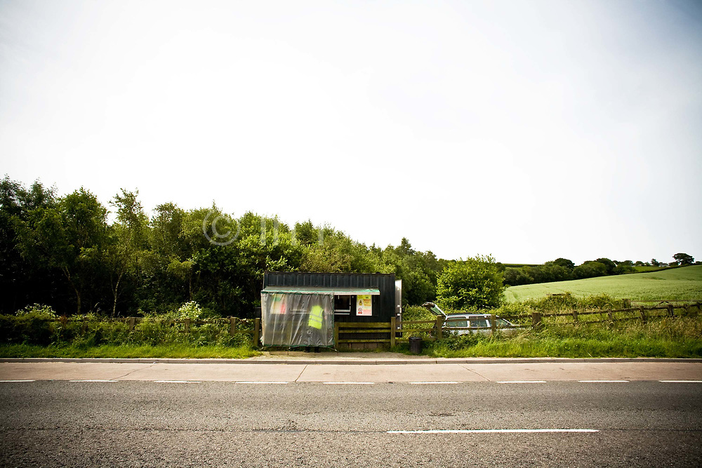 A roadside burger van positioned in a field next to a layby on the A30 on the 24th June 2008 in Exeter in the United Kingdom.