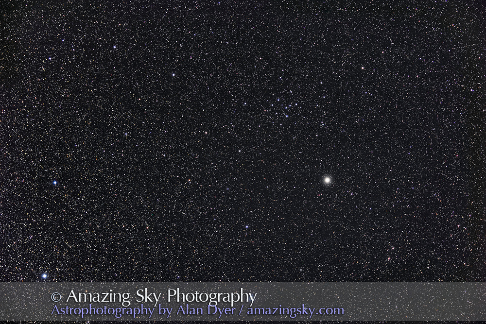 The large and sparse open cluster in Ophiuchus called IC 4665, an object easy in binoculars. The star at centre is Celbalrai or Beta Ophiuchi. The 7.5 x 5° field is close to a binocular field of  view. <br /> <br /> This is a stack of 9 x 4-minute exposures with the SharpStar 61mm apo refractor at f/4.5 and with the Canon R6 at ISO 800. Taken from home October 1, 2021 on a slightly hazy night with the field into the southwest.