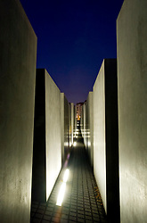 Illuminated concrete blocks at the Memorial to the Murdered Jews of Europe in central Berlin Germany 2008