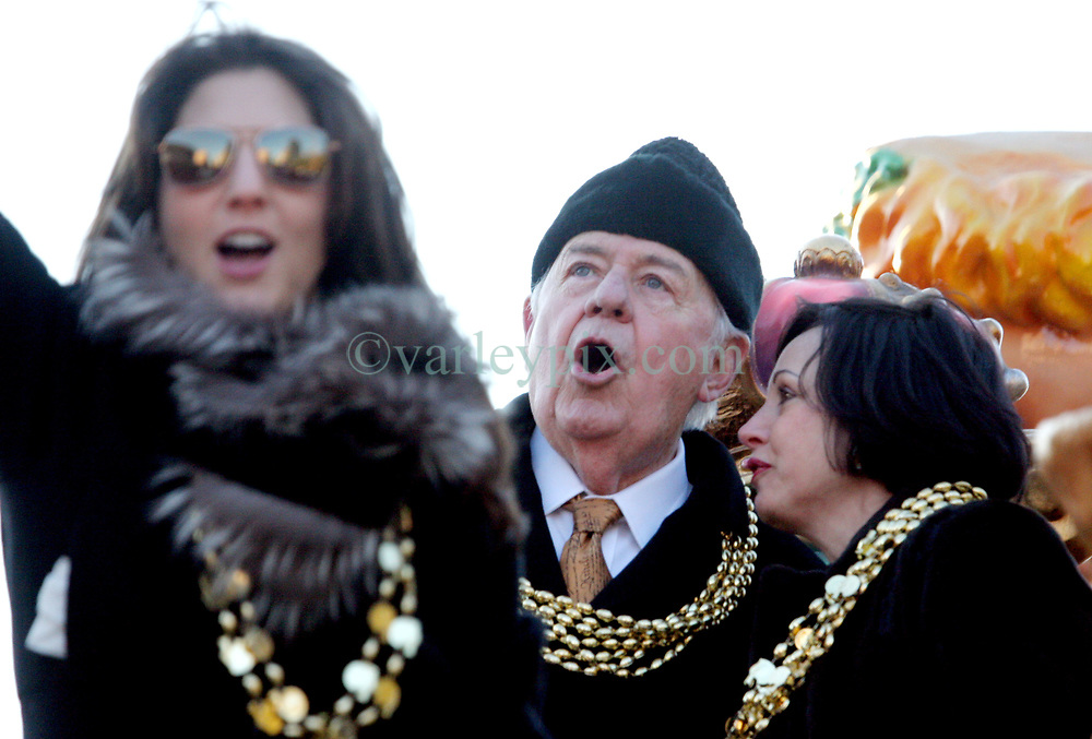 09 February 2010. New Orleans, Louisiana, USA. <br /> Tom Benson, owner of the Saints with grand daughter Rita Benson Leblanc (l) and wife Gayle (rt) leads the team as Saints Mania captures New Orleans like no other parade. The New Orleans Saints victorous NFL football team makes its way from the Superdome through the city. Drew Brees and the crew make their way through screaming fans. The team salutes the massed crowds along the victory parade route in downtown New Orleans following the team's stunning victory over the Indianapolis Colts for Superbowl 44. <br /> Photo ©; Charlie Varley. Varleypix.com
