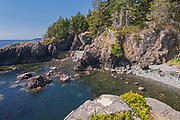 Rocky shoreline at edge of Sandcut Beach. STrait of Juan de Fuca<br />Jordan River Regional Park<br />British Columbia<br />Canada