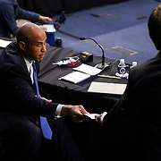 Sen. Cory Booker (D-N.J.) receives a note from Sen. Ben Sasse (R-Neb.) during a Senate Judiciary Committee business meeting prior to the fourth day for the confirmation hearing of President Donald Trump's Supreme Court nominee Judge Amy Coney Barrett on Thursday, October 15, 2020.