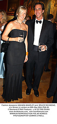 Fashion designers AMANDA WAKELEY and  BRUCE RICHMOND, at a dinner in London on 26th May 2004.PUN 99
