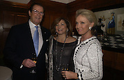 Roger Moore, Dorit Zarach, Mrs. Roger Moore ( Kiki tholstrup)  , Olga Polizzi and Rocco Forte host a party to celebrate the re-opening of Brown's Hotel  after a  £19 million renovation. Albermarle St. London. 12 December 2005. ONE TIME USE ONLY - DO NOT ARCHIVE  © Copyright Photograph by Dafydd Jones 66 Stockwell Park Rd. London SW9 0DA Tel 020 7733 0108 www.dafjones.com