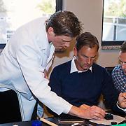 NLD/Amsterdam/20131003 -  Dad's moment , Ronald de Boer en Jacob van Rozelaar bij de horloge workshop