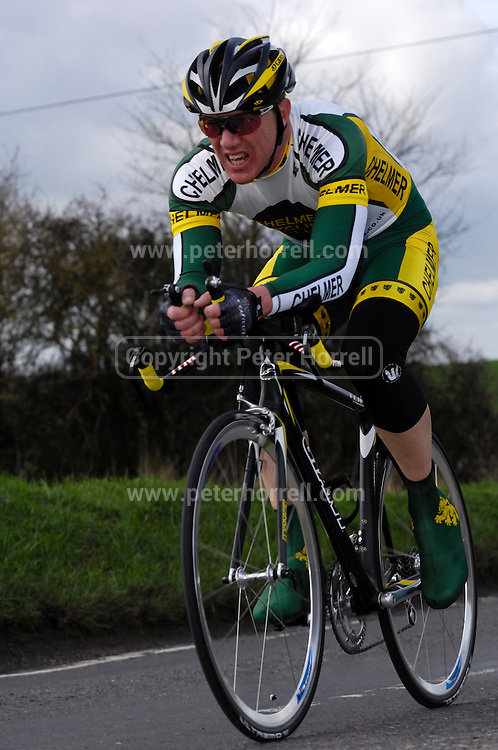 United Kingdom, Finchingfield, Mar 27, 2010: Clive Richardson, Chelmer CC, approaches the 4 miles to go marker during the 2010 edition of the 'Jim Perrin' Memorial Hardriders 25.5 mile Sporting TT promoted by Chelmer Cycling Club. Copyright 2010 Peter Horrell.