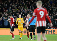 SHEFFIELD, ENGLAND - DECEMBER 05: <br /> Sheffield United's Dean Henderson remonstrates with Referee Stuart Attwell after Newcastle United were awarded a Jonjo Shelvey goal by VAR during the Premier League match between Sheffield United and Newcastle United at Bramall Lane on December 5, 2019 in Sheffield, United Kingdom. (Photo by Rich Linley - CameraSport via Getty Images)