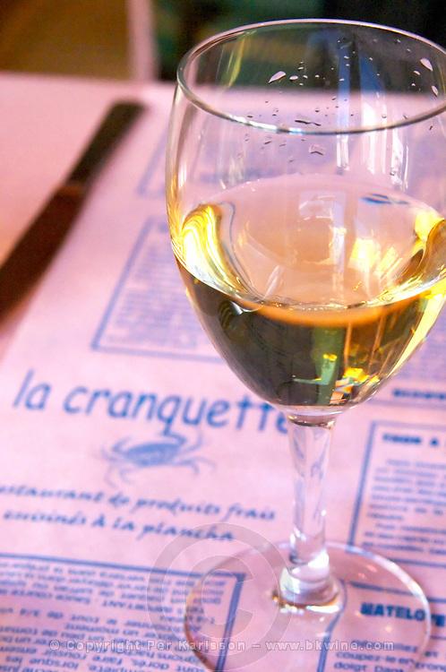 Gruissan village. La Clape. Languedoc. Restaurant La Cranquette. France. Europe. Wine glass.