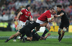 British and Irish Lions Jack McGrath is tackled by New Zealand's Codie Taylor during the second test of the 2017 British and Irish Lions tour at Westpac Stadium, Wellington.