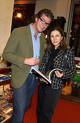YVETTE RIACHI and JOHN TURCAN at a drinks party for the Game Conservancy Trust's committee held at Williams & Son, 10 Mount Street, London WlK hosted by Willaim & Lucy Asprey on 6th December 2005.<br /><br />NON EXCLUSIVE - WORLD RIGHTS