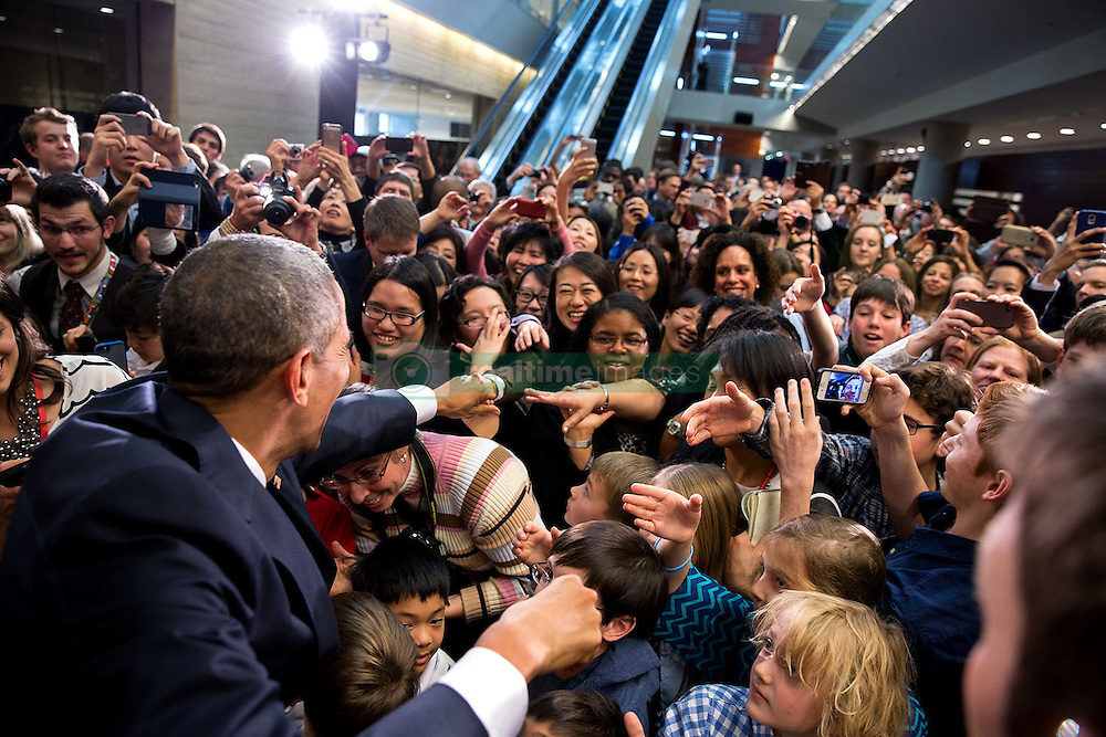 President Barack Obama shakes hands with U.S. Embassy staff and their families during a meet and greet at the U.S. Embassy in Beijing, China, Nov. 10, 2014. (Official White House Photo by Pete Souza)<br /> <br /> This official White House photograph is being made available only for publication by news organizations and/or for personal use printing by the subject(s) of the photograph. The photograph may not be manipulated in any way and may not be used in commercial or political materials, advertisements, emails, products, promotions that in any way suggests approval or endorsement of the President, the First Family, or the White House.