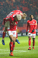 Charlton Athletic forward Lyle Taylor (9) celebrates with Charlton Athletic midfielder Chris Solly (20) after scoring a goal (1-0) during the EFL Sky Bet League 1 match between Charlton Athletic and AFC Wimbledon at The Valley, London, England on 15 December 2018.