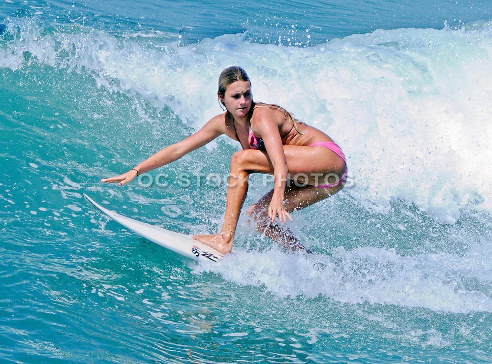 Female in Bikini Surfing Waves in Huntington Beach
