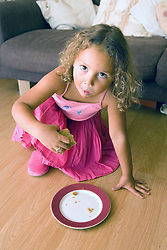 Young girl eating a snack,