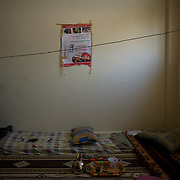 A poster of the Syrian revolution in a wall at an improvised room in a refugee center in Wadi Khaled, northern Lebanon.